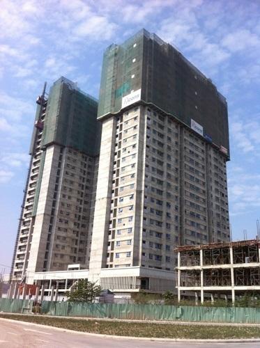 Sau hơn 5 năm triển khai, hai tòa chung cư giờ đây mới xây đến tầng 28
