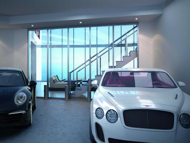 Ngồi trong phòng khách, các tỷ phú có thể thoải mái ngắm những chiếc siêu xe yêu thích của mình ngay bên cạnh