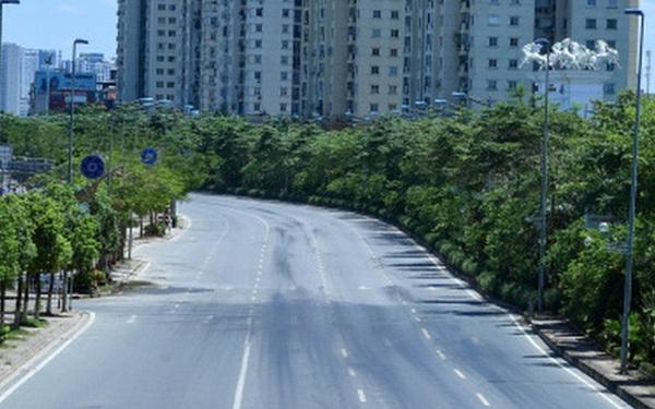 Nhiệt độ mặt đường có nơi hơn 50 độ C, phố phường Hà Nội vắng hoe