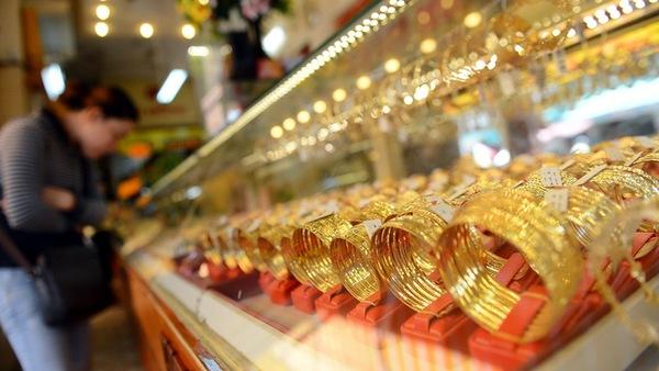 Giá vàng giảm mạnh xuống dưới 1.230 USD/ounce
