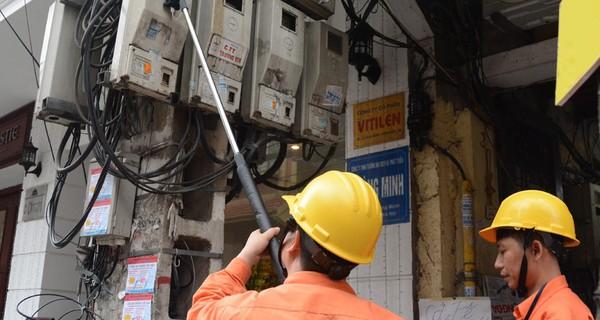 EVN bổ sung quy định mời dân giám sát ghi số điện
