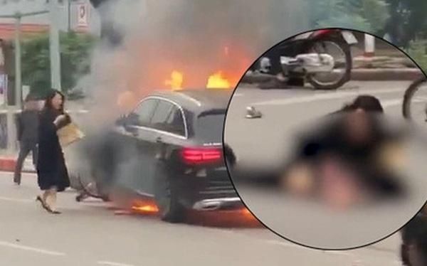 Xuất hiện clip người phụ nữ nghi là tài xế Mercedes hoảng loạn tại hiện trường, chạy đến ôm nạn nhân đang nằm gục