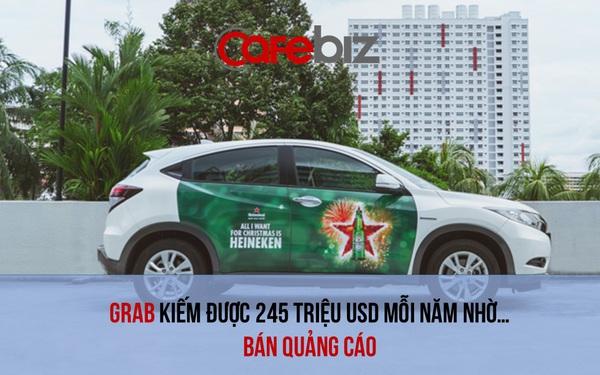 Sự 'nguy hiểm' của những mảng kinh doanh phụ: Cho dán banner trên thân xe, chạy video quảng cáo sau ghế, Grab kiếm hàng trăm triệu USD mỗi năm