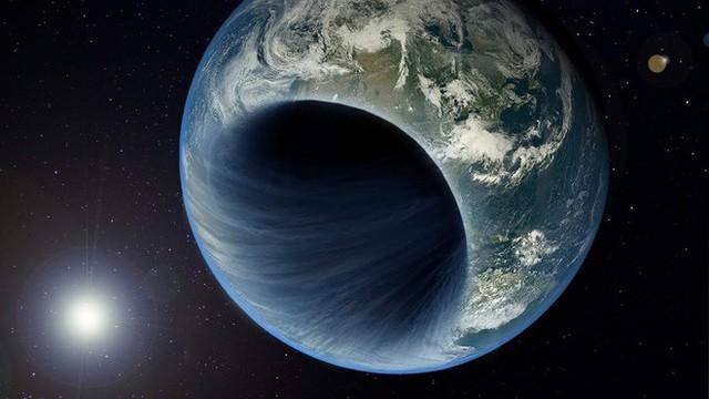 Nếu một lỗ đen nhỏ bằng đồng xu xuất hiện trên Trái Đất, điều gì sẽ xảy đến với chúng ta? - Ảnh 2.