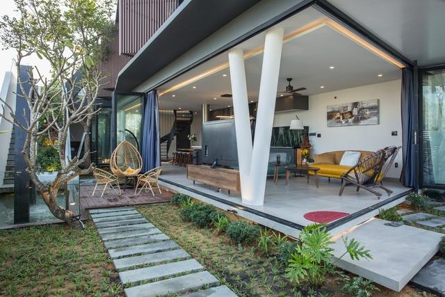 Nhà 2 tầng mở hoàn toàn với cửa kính, cả sân thượng là vườn trồng rau và khu vui chơi - Ảnh 14.
