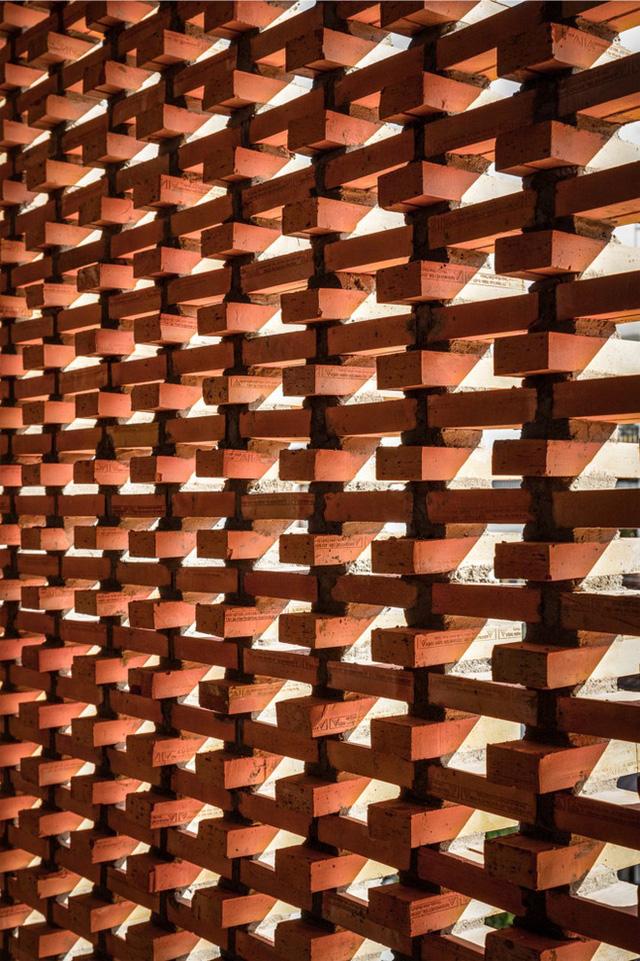 Công trình bằng gạch nung được cải tạo từ nhà kho ở Phan Thiết, đẹp lung linh trên báo Mỹ - Ảnh 9.