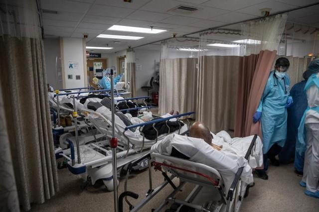 New York quay cuồng trong dịch bệnh: Rất nhiều bệnh nhân tử vong, chúng tôi choáng ngợp và mệt mỏi - Ảnh 8.