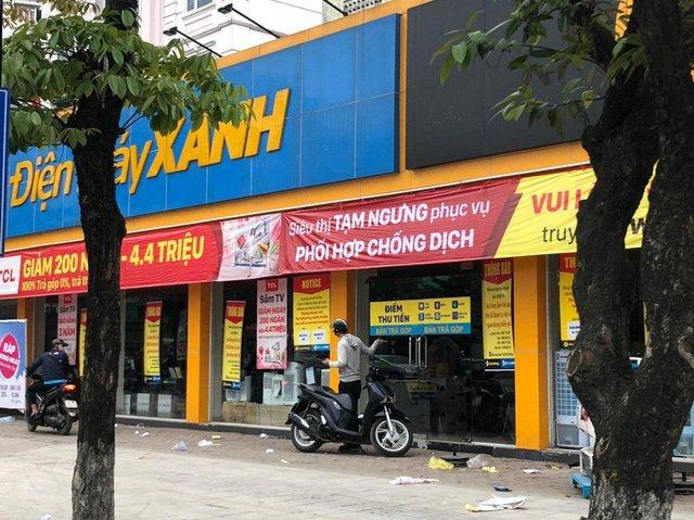 Các cửa hàng điện thoại, điện máy phải đóng cửa vì dịch Covid-19, nhà đầu tư bán tháo cổ phiếu Thế Giới Di Động - Ảnh 1.