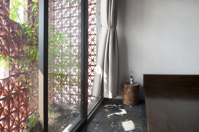 Ngôi nhà ở Nam Định lấy cảm hứng từ cây chuối - Ảnh 10.