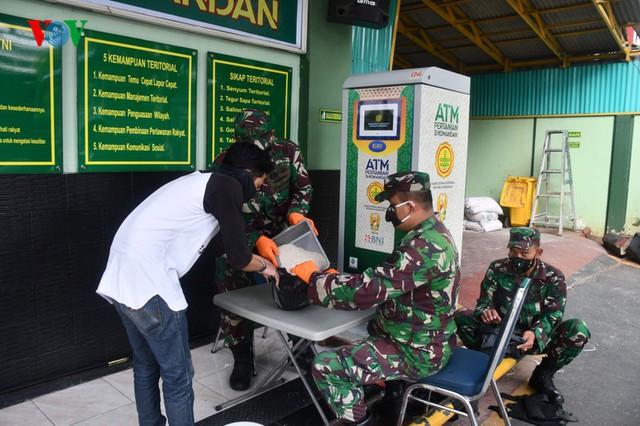 Học Việt Nam, Indonesia triển khai ATM gạo cho người nghèo - Ảnh 1.