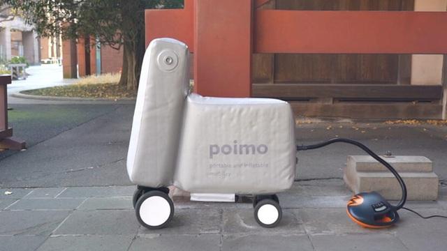 Nhật Bản phát minh thành công mẫu xe điện bơm phồng, có thể gấp gọn cho vừa vào balo khi không sử dụng - Ảnh 2.