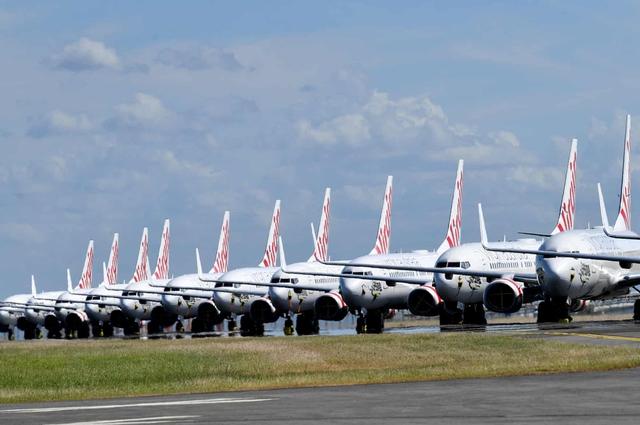 La liệt máy bay nằm không tại sân bay trên khắp thế giới - Ảnh 5.