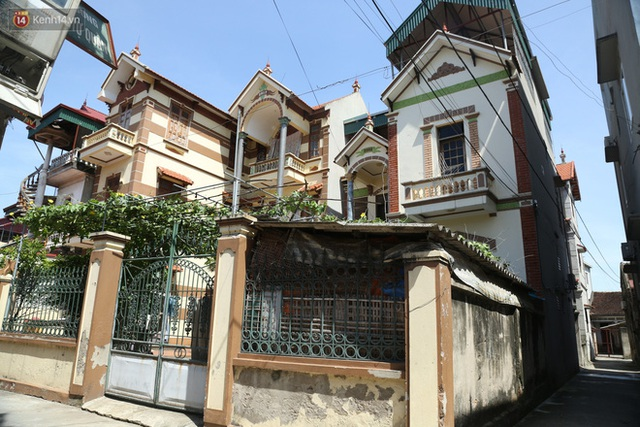 Hà Nội: Nhà tầng, biệt thự mọc san sát nhau ở ngôi làng phất lên từ việc buôn thịt lợn - Ảnh 11.