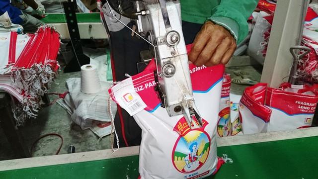 Vượt Thái Lan, Việt Nam có giá gạo xuất khẩu cao nhất thế giới - Ảnh 1.