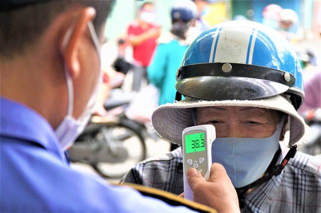 Ảnh: Ngày đầu người dân Đà Nẵng thực hiện đi chợ bằng phiếu ngày chẵn lẻ - Ảnh 13.