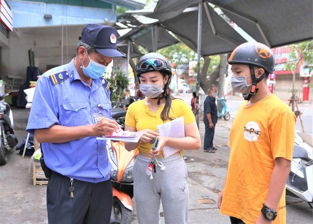 Ảnh: Ngày đầu người dân Đà Nẵng thực hiện đi chợ bằng phiếu ngày chẵn lẻ - Ảnh 10.