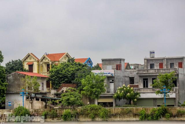 Bên trong khu phố ở Hà Nam bị phong tỏa vì ca mắc COVID-19 - Ảnh 14.
