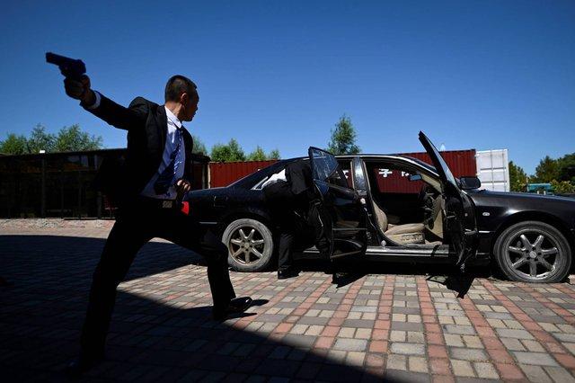 'Lò luyện' vệ sĩ cho giới siêu giàu ở Trung Quốc: Khắt khe hơn quân đội, tốt nghiệp có thể có thu nhập 70.000 USD/năm - Ảnh 1.