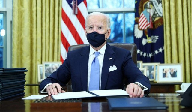 Sau lễ nhậm chức, ông Biden hủy bỏ nhiều sắc lệnh dưới thời ông Trump  - Ảnh 1.