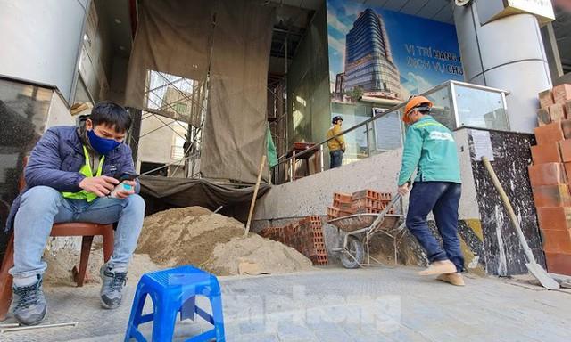 Hà Nội xử cao ốc biến văn phòng thành căn hộ khách sạn không phép - Ảnh 4.