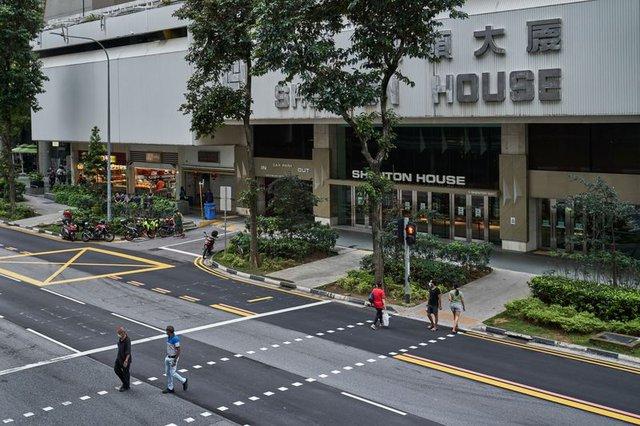 Trung tâm tài chính 50 tỷ USD của Singapore: Niềm tự hào của đảo quốc sư tử vắng vẻ chưa từng có, đối mặt với thách thức sinh tồn - Ảnh 3.