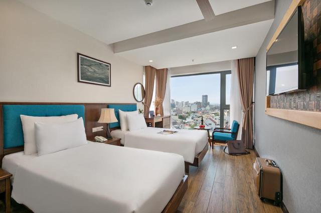 """Loạt khách sạn 4 sao Đà Nẵng giá rẻ """"giật mình"""": Chưa tới 500k/đêm, vị trí ngay trung tâm, có cả hồ bơi, ăn sáng miễn phí - Ảnh 7."""
