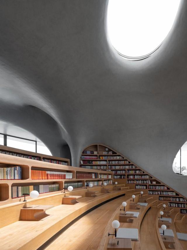 Thư viện nằm bên bờ biển có cấu trúc độc lạ, có một không hai - Ảnh 6.