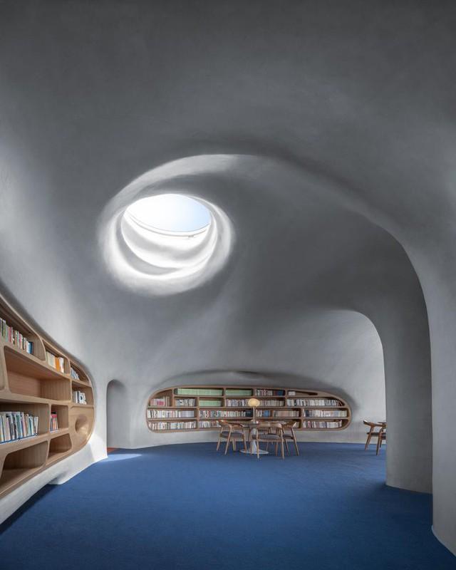 Thư viện nằm bên bờ biển có cấu trúc độc lạ, có một không hai - Ảnh 10.