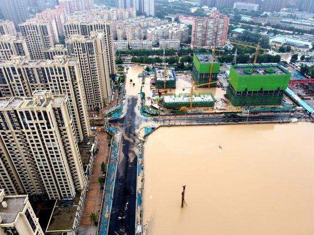 'Mưa lớn nhất 1.000 năm' gây lụt nặng ở tỉnh miền trung Trung Quốc - Ảnh 5.