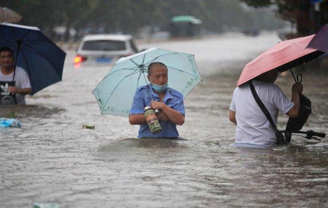 'Mưa lớn nhất 1.000 năm' gây lụt nặng ở tỉnh miền trung Trung Quốc - Ảnh 9.