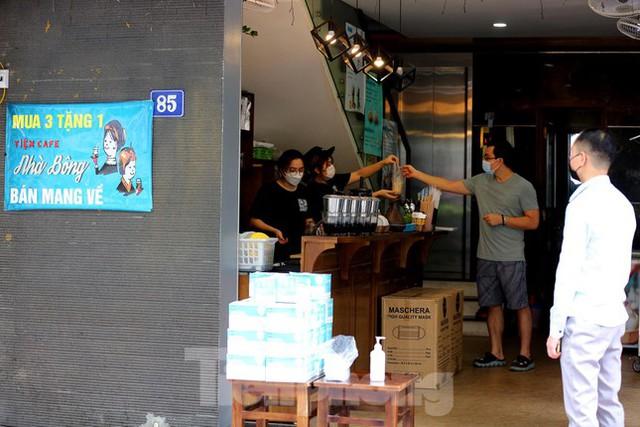 Hà Nội: Dịch vụ sửa xe và điện lạnh đắt khách ngay khi hoạt động trở lại ở vùng xanh - Ảnh 4.