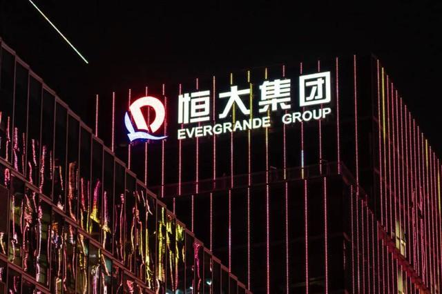 Thị trường tiền số chao đảo vì Evergrande, hãng bất động sản thích đi lắp xe điện - Ảnh 2.
