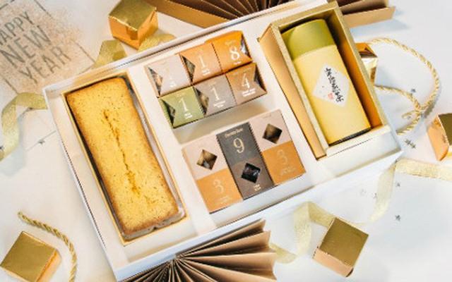 Một cửa hàng làm bánh Nhật trên đường Lê Thánh Tôn, quận 1, TP HCM quyết định sản xuất quy mô lớn dòng bánh có tên Golden Fruit Pound Cake phủ vàng thật có thể ăn được (Ảnh: Bizlive)