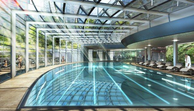 Hồ bơi của tòa nhà chọc trời này được thiết kế trong nhà và đường bơi cong.