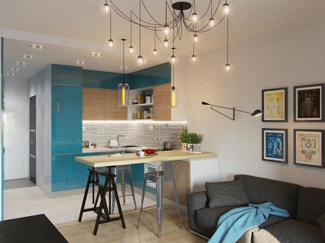 Sâu vào trong là bếp, bàn ăn, phòng khách, góc làm việc và cuối cùng là phòng ngủ. Vì diện tích hẹp bề ngang và dài nên các không gian chức năng được bố trí dọc hai bên căn hộ.