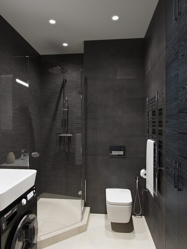 Trái ngược với không gian nhiều màu sắc bên ngoài, khu vực nhà tắm lại là sự kết hợp hài hòa của hai tông màu đen trắng tạo không gian sang trọng và sạch sẽ.