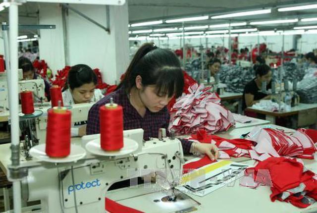 Chiến tranh thương mại Mỹ - Trung tác động đến kinh tế Việt Nam như thế nào? - Ảnh 1.
