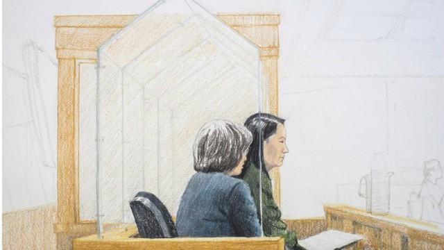 Ngột ngạt phiên xét xử đằng sau 2 lớp kính chống đạn của sếp Huawei Mạnh Vãn Chu - Ảnh 1.