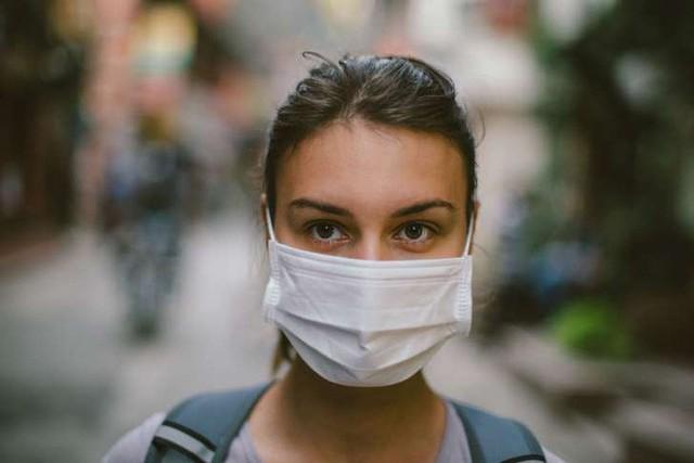 Khẩu trang y tế có tác dụng ngăn ngừa bệnh cúm hay không? - Ảnh 1.