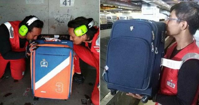 Nhân viên bốc xếp của AirAsia phải ôm, hôn từng chiếc vali sau khi bị tố quăng quật hành lý - Ảnh 1.