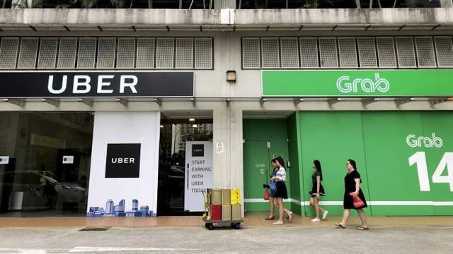 Singapore điều tra vụ Grab mua lại Uber Đông Nam Á - Ảnh 1.