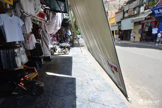 Nắng nóng gần 50 độ C, người Hà Nội dựng lô cốt mềm chống nóng - Ảnh 9.