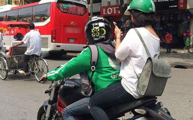 Từ chuyện xe ôm Grab lách luật, chuyên gia khẳng định: Muốn phát triển kinh tế nền móng, người Việt cần từ bỏ kiểu lợi ích cá nhân cục bộ - Ảnh 1.