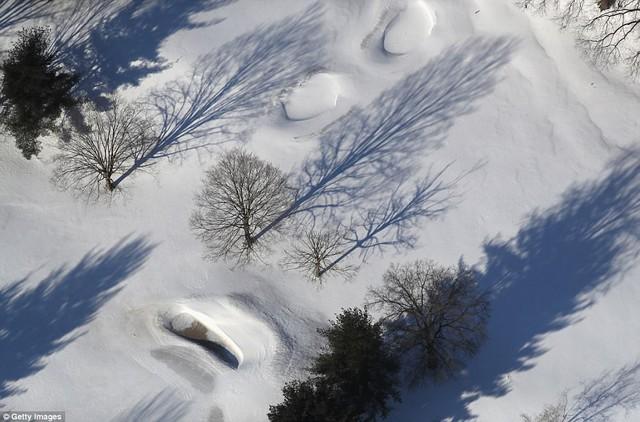 Sau trận bão tuyết kinh hoàng, thành phố New York hoang tàn, ảm đạm như trong phim Ngày Tận Thế - Ảnh 21.