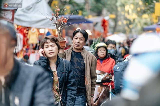 Rộn ràng không khí Tết tại chợ hoa Hàng Lược - phiên chợ truyền thống lâu đời nhất ở Hà Nội - Ảnh 5.