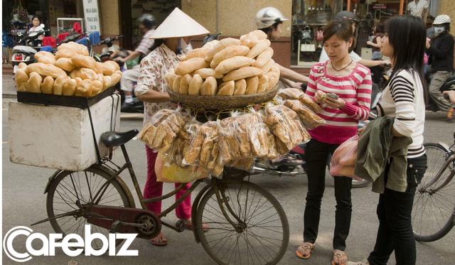 Báo ngoại kể câu chuyện bánh mì Việt: Từ khởi đầu khiêm tốn đến món ăn 'thần thánh' chinh phục cả thế giới, từ 20.000 đồng đến cả 100 USD/ổ nhưng không thiếu người muốn thử - Ảnh 3.