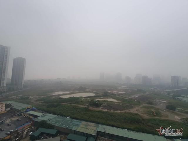 Sương mù giăng phủ Hà Nội, cao ốc mất hút - Ảnh 5.