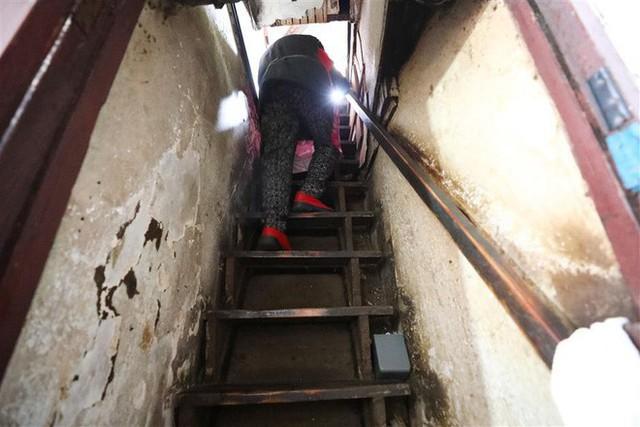Cận cảnh cuộc sống lao đao trong tòa nhà mỏng như tờ giấy ở Thượng Hải - Ảnh 7.