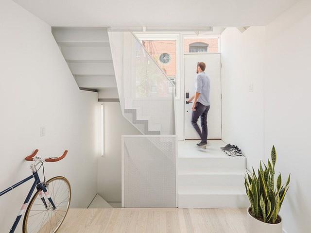 Ngôi nhà 32m² thiết kế như tòa cao ốc mini khiến ai nấy đều trầm trồ - Ảnh 5.