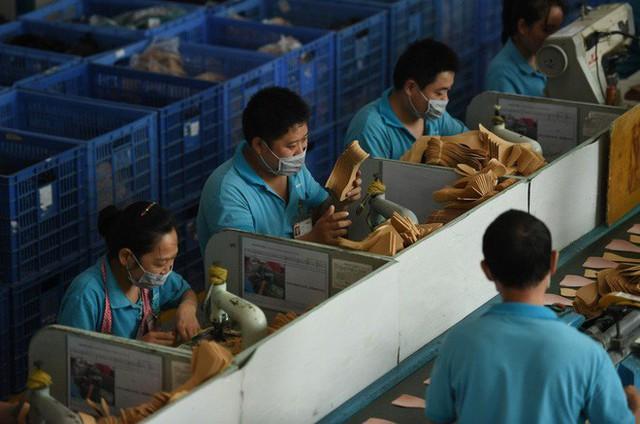 Im thin thít và lặn mất tăm: Cách các doanh nghiệp rời TQ sang Việt Nam tránh bão thương chiến - Ảnh 2.